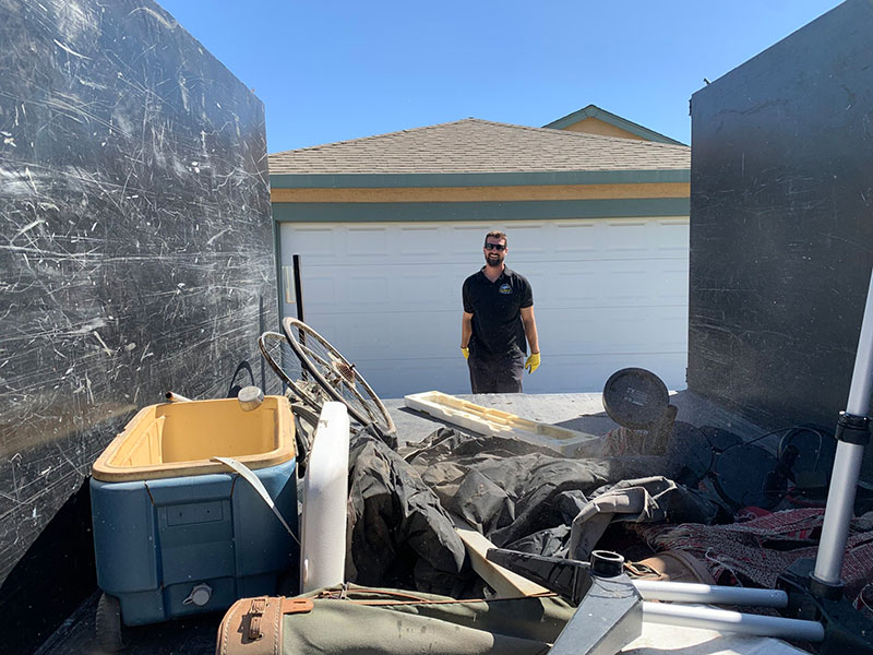 Junk removal expert performing junk removal services